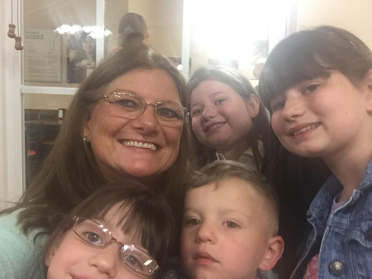 Sherry with her grandchildren