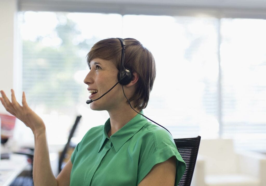 Woman talking on the phone with a headset
