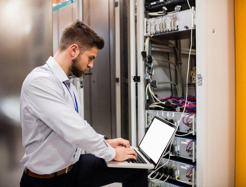 Employee working on network hardware