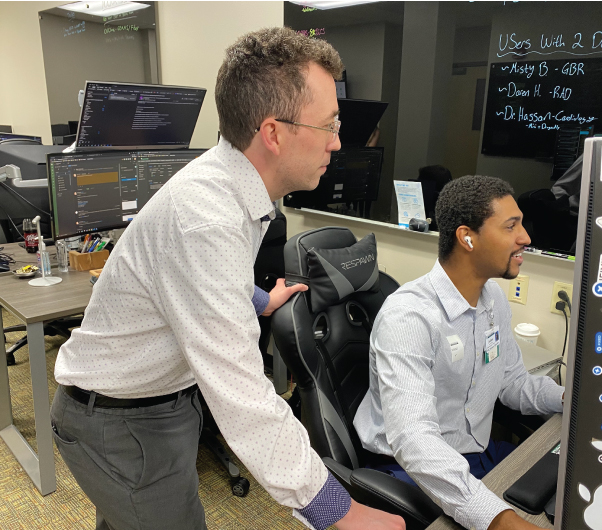 Two engineers monitoring a network security system